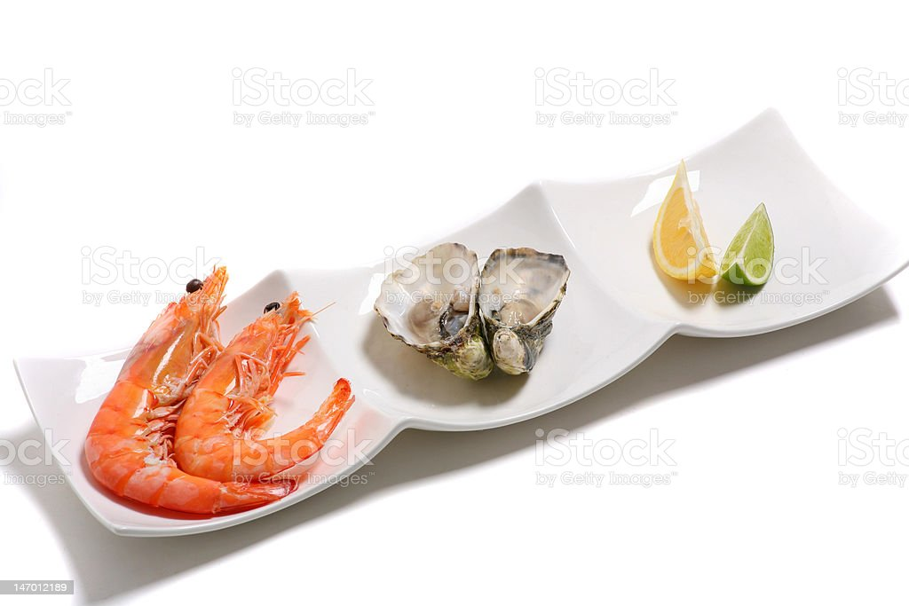 Prawns and oysters on a plate royalty-free stock photo