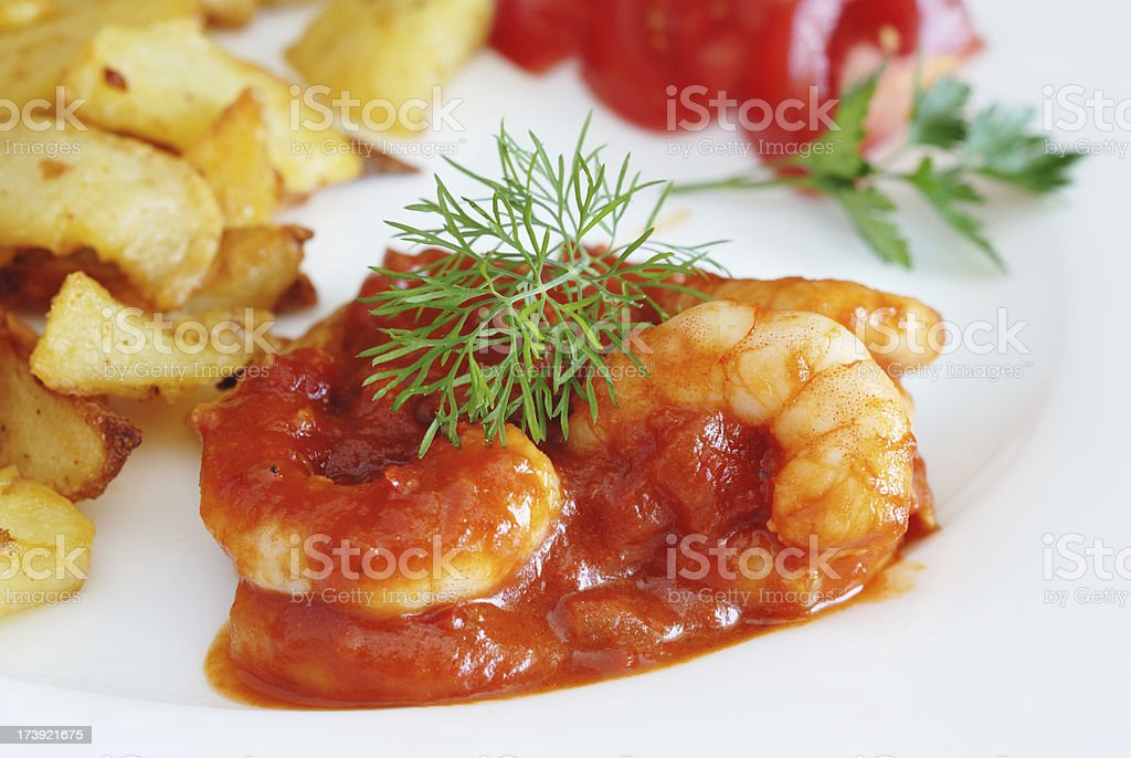 prawns in tomato sauce stock photo