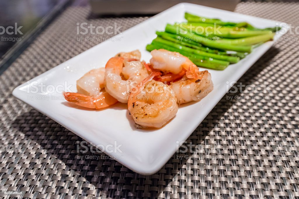 Prawns teppanyaki with asparagus stock photo