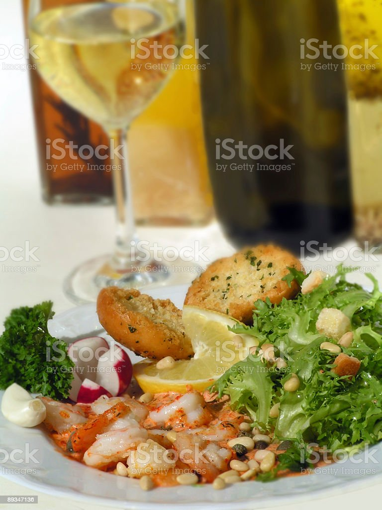 prawns with salad and sauce of white wine royalty-free stock photo
