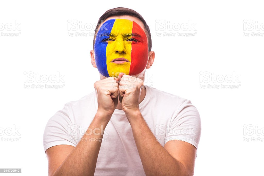 Pray and ask for a win Romanian football fan stock photo