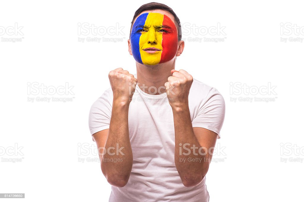Pray and cry emotions for Romanian football fan stock photo