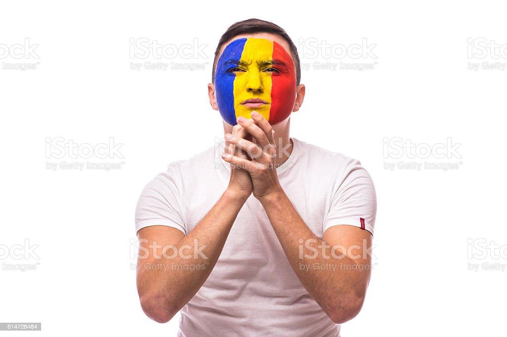 Pray and cry Romanian football fan stock photo
