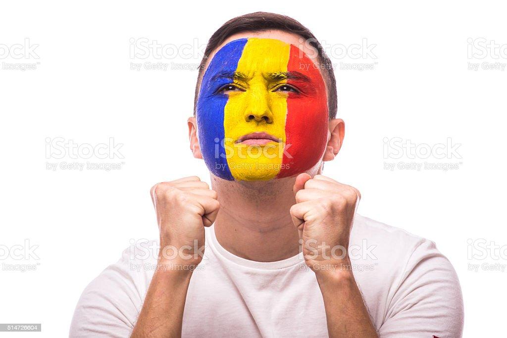 Pray and wish for win Romanian football fan stock photo
