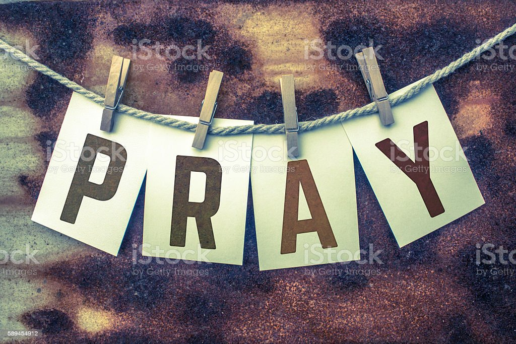Pray Concept Pinned Cards and Rust stock photo