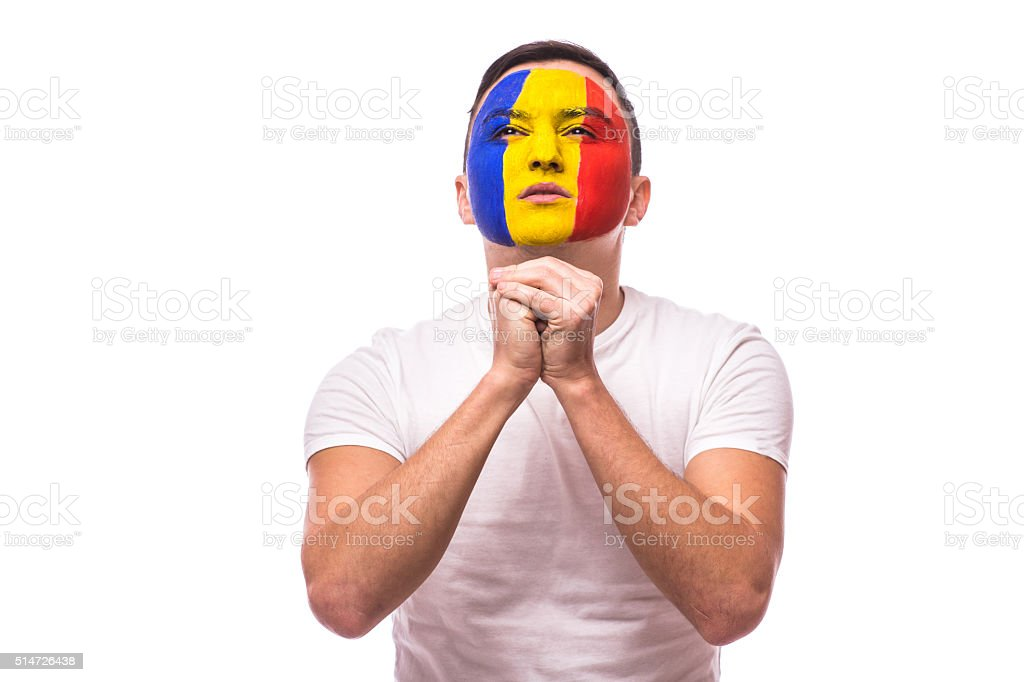 Pray for a goal football fan in game Romania national stock photo