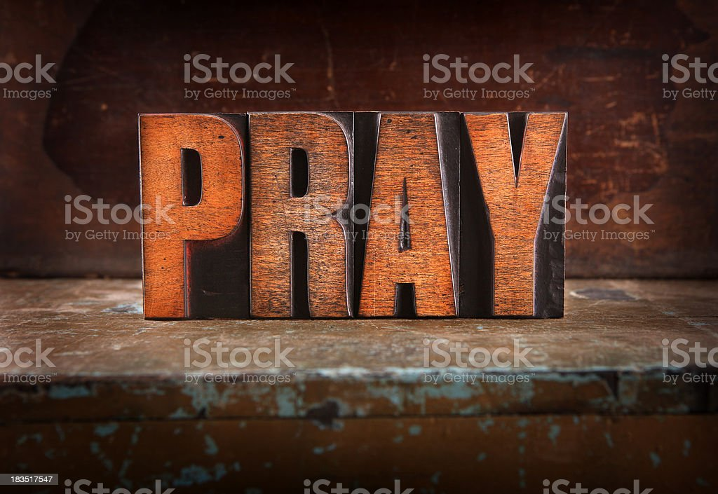 Pray - Letterpress letters royalty-free stock photo