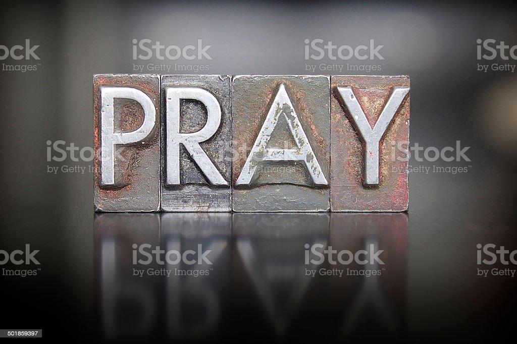 Pray Letterpress stock photo