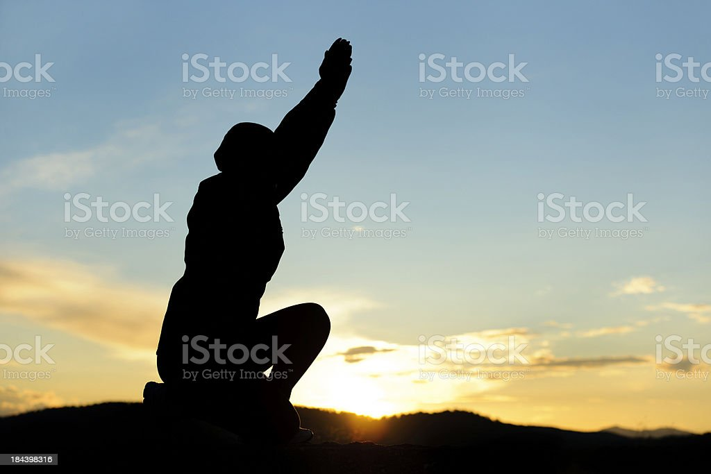pray silhouette royalty-free stock photo