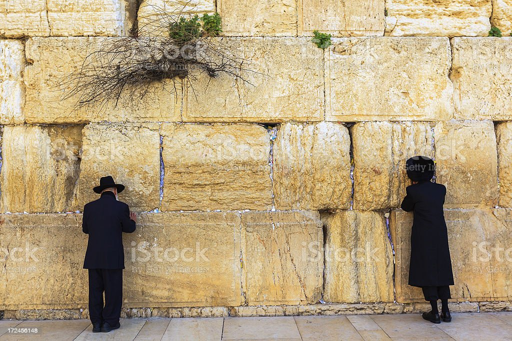 Prayer at the Western Wall in Jerusalem royalty-free stock photo