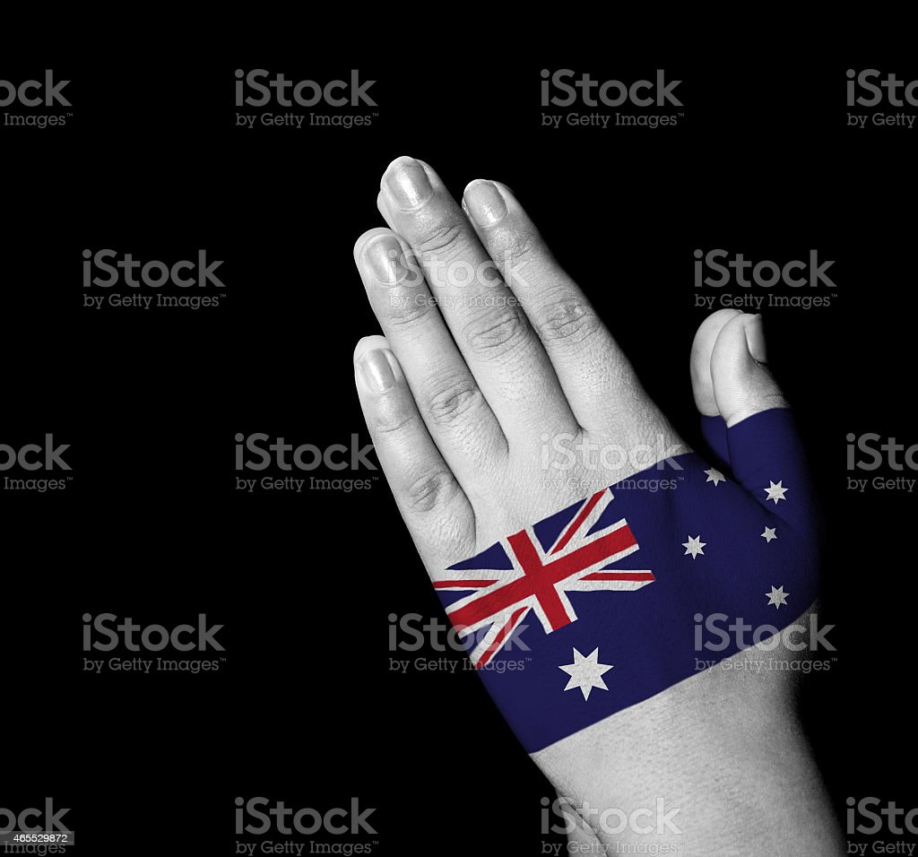 Prayer - Australia flag painted on hands stock photo