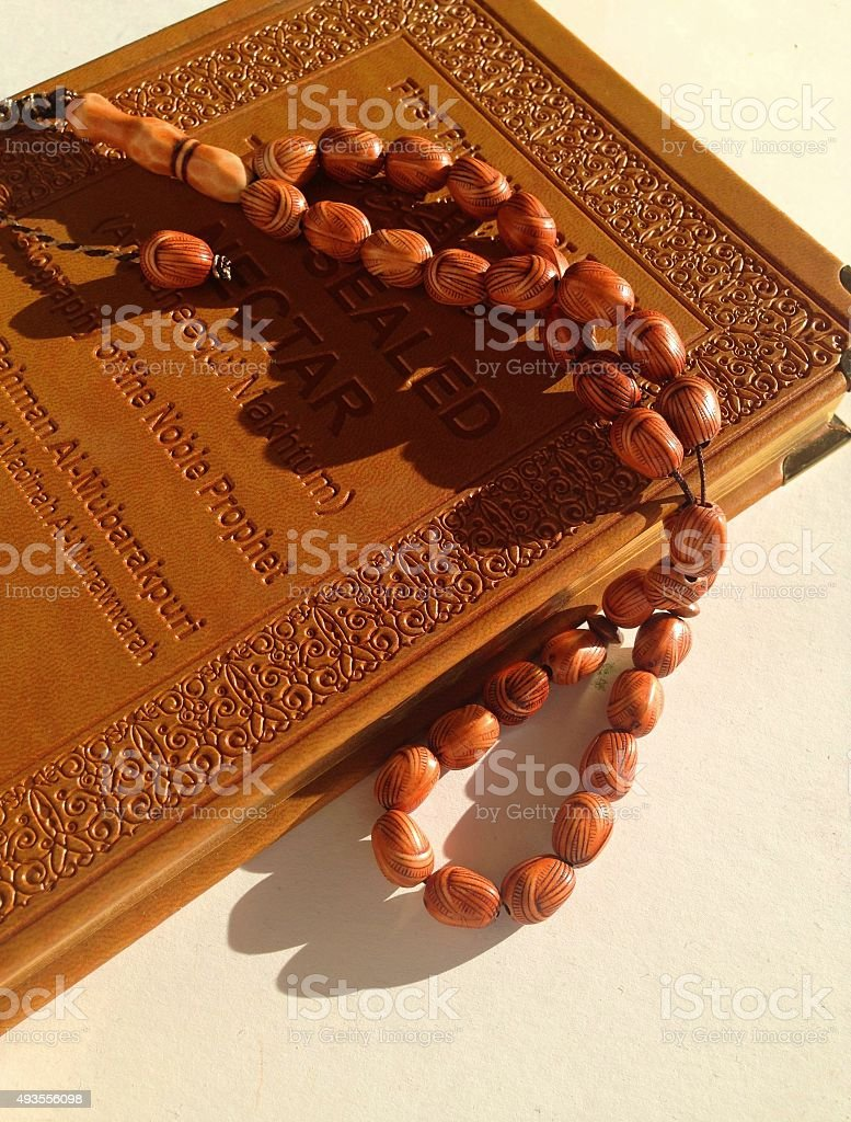 Rosary beads on a religious book. stock photo
