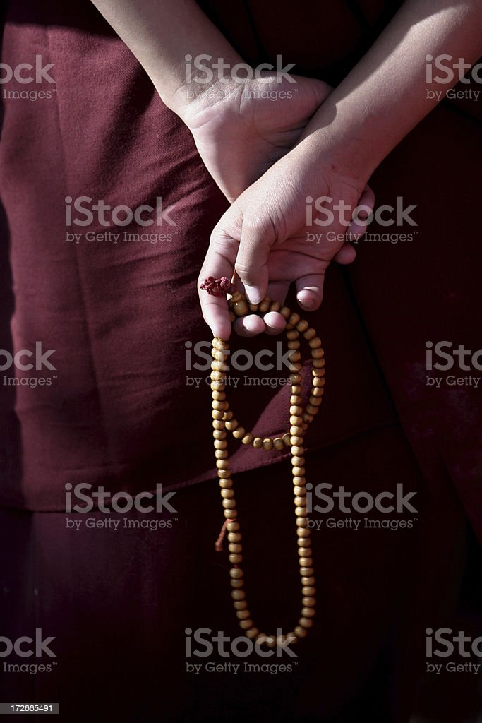 Prayer Beads in the hands of a monk stock photo