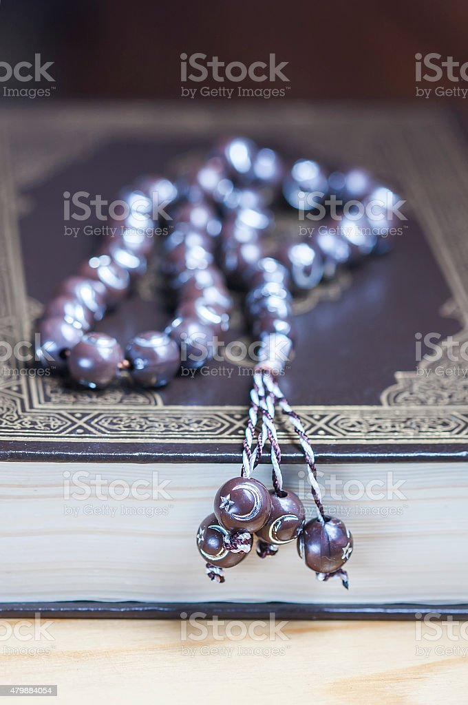 Prayer beads on the Koran. Selective focus stock photo