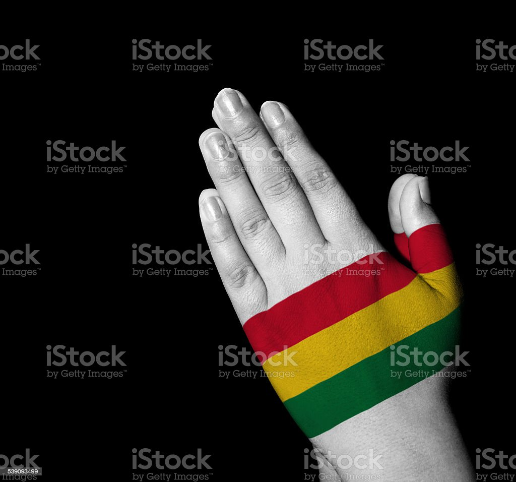 Prayer - Bolivia flag painted on hands stock photo