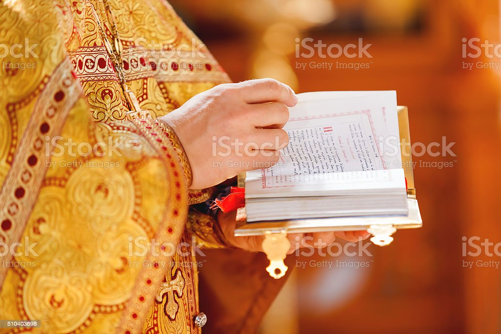 Prayer book in hands of the priest. Orthodox Christian Church stock photo