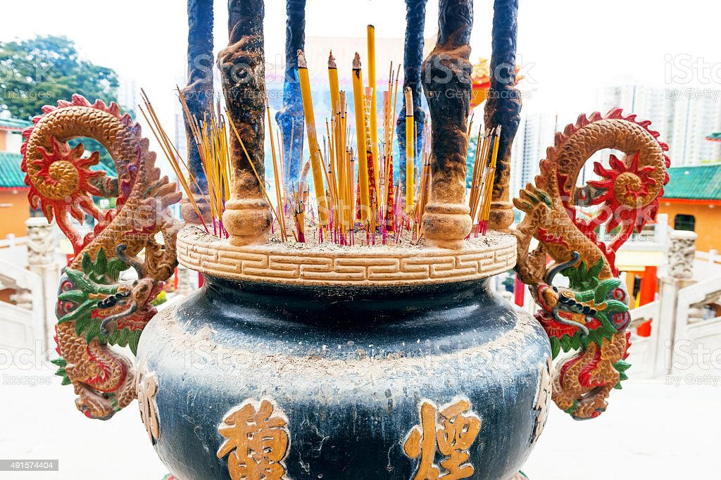 Prayer candle in a clay bowl, dragons, Chengdu, Sichuan ,China stock photo