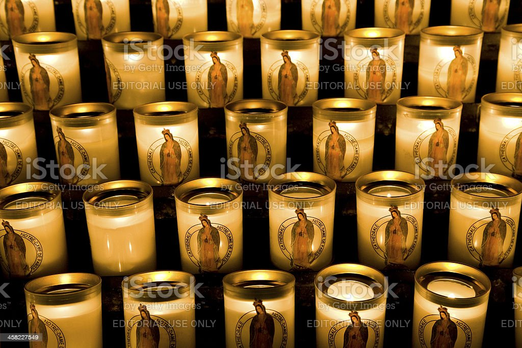 Prayer candles burning at the Notre Dame Cathedral royalty-free stock photo