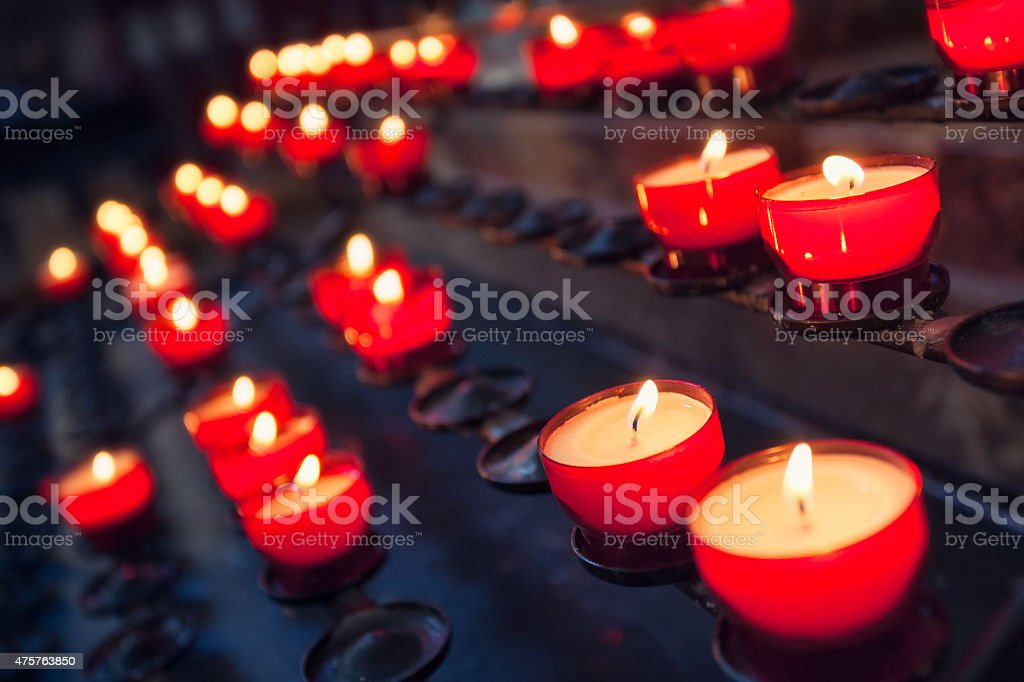 Prayer candles in a church stock photo