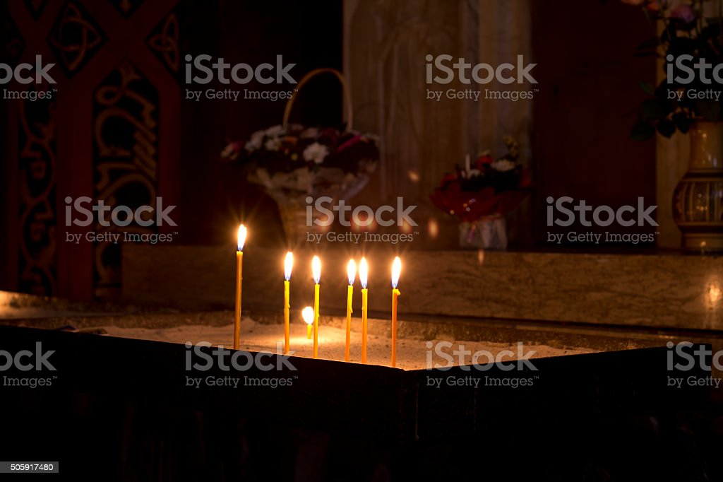Prayer Candles in orthodoxy church stock photo