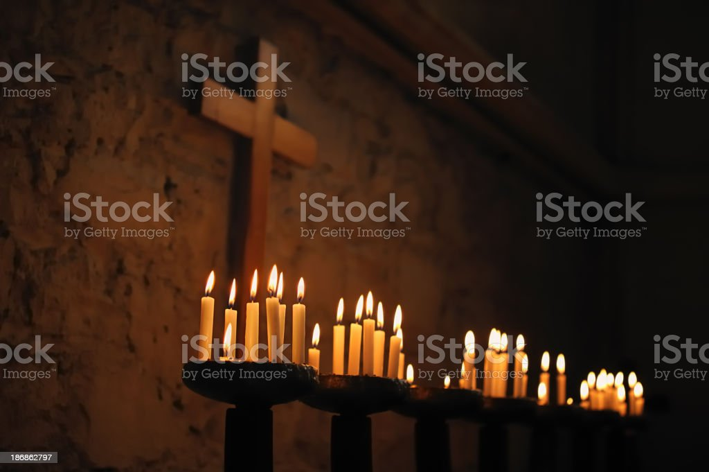 Prayer Candles with Religious Cross stock photo