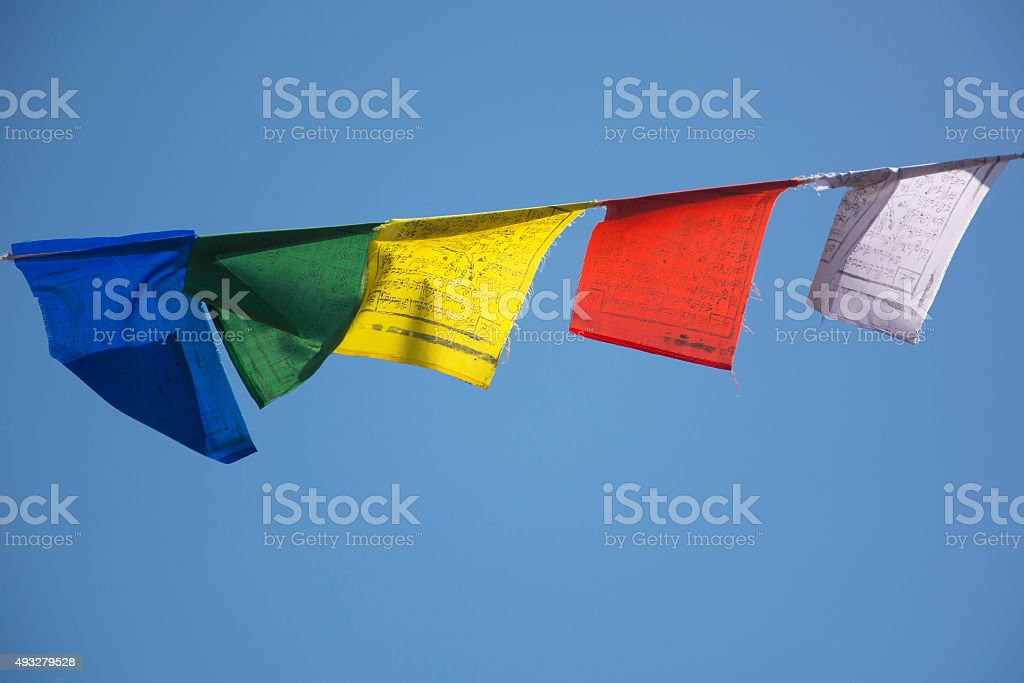 Prayer Flags against a Blue Sky stock photo