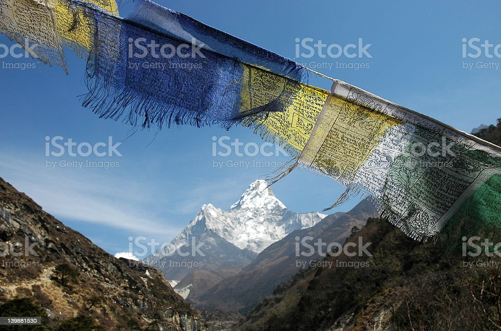 Prayer flags and Ama-Dablam mount stock photo