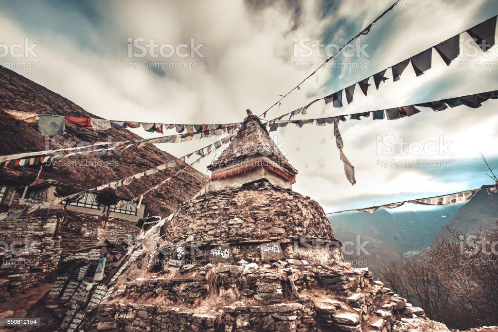Prayer flags and buddhist stupa on trekking route stock photo