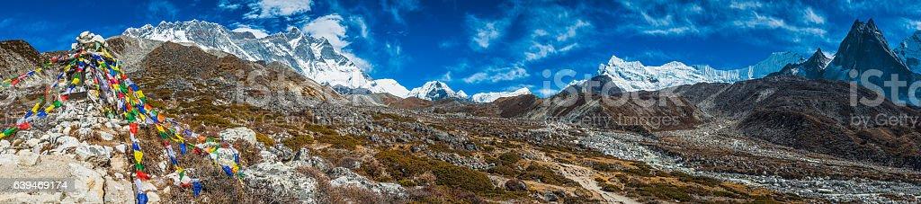 Prayer flags and mountain peaks panorama high Himalayas Lhotse Nepal stock photo