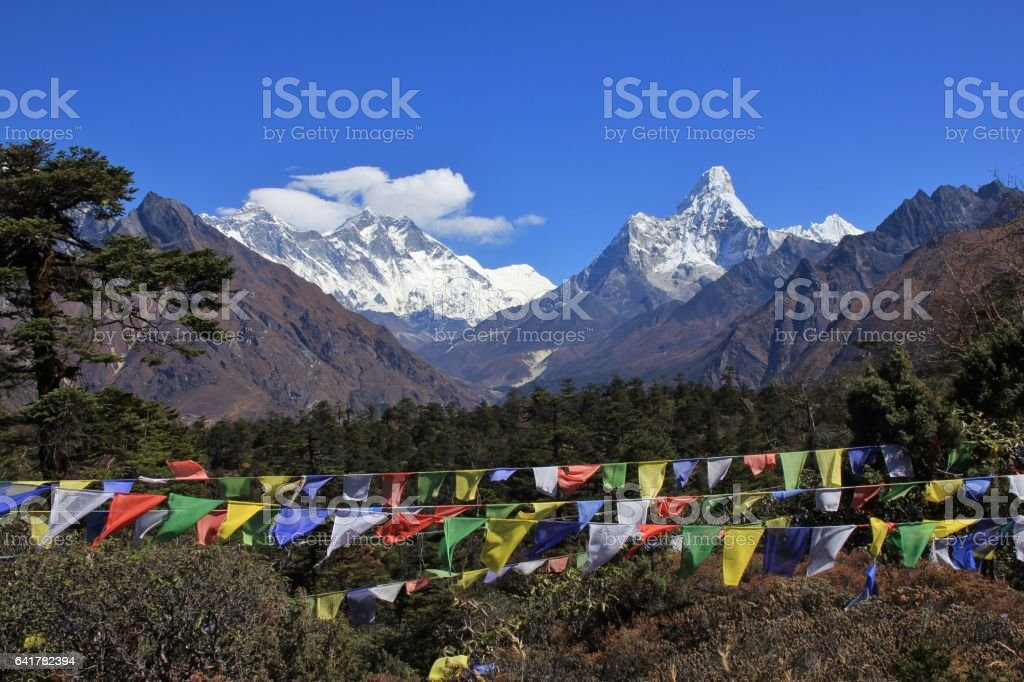 Prayer flags and snow capped mountains Lhotse and Ama Dablam stock photo
