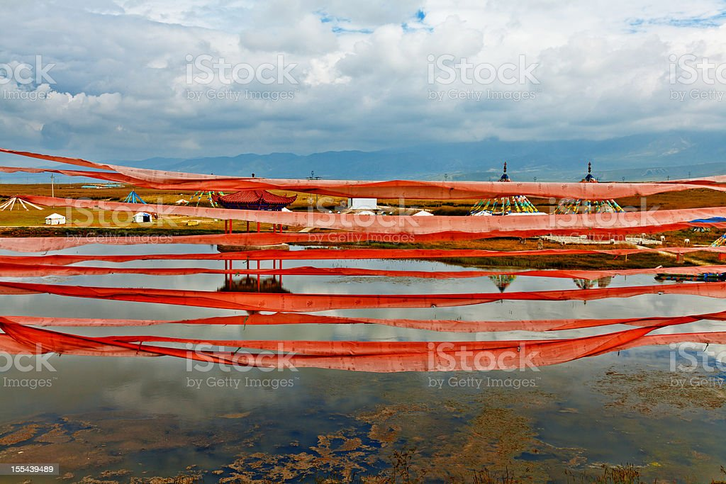 Prayer flags at the lakeside stock photo