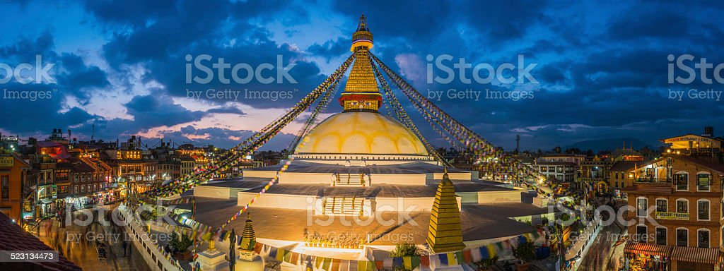 Prayer flags Buddhist stupa illuminated panorama at Boudhanath Kathmandu Nepal stock photo