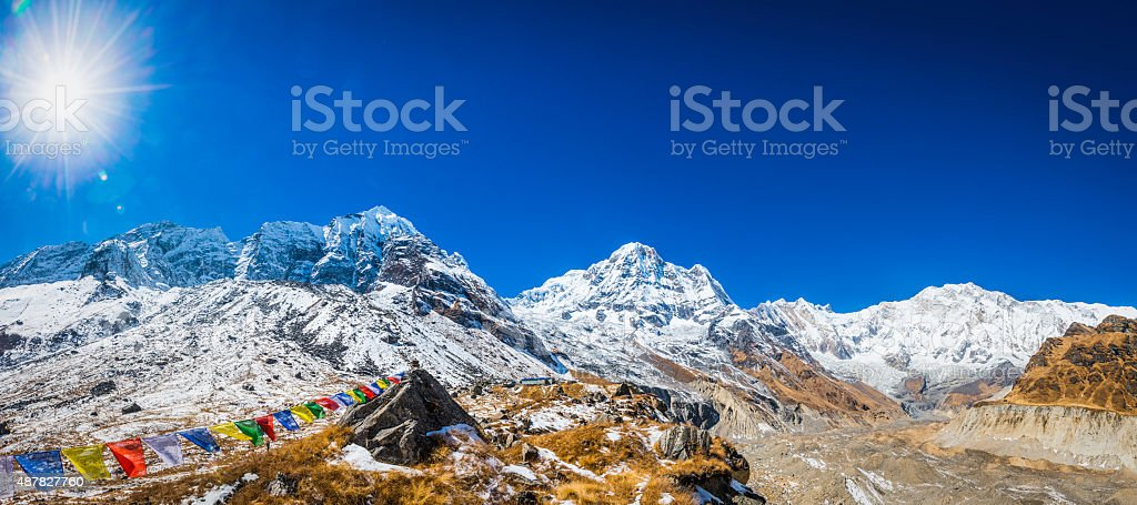 Prayer flags fluttering in Annapurna Sanctuary Himalaya mountain peaks Nepal stock photo