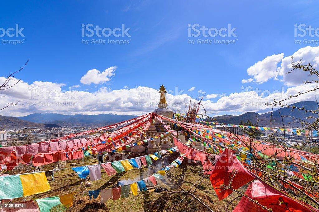 Prayer flags flying on the Pagoda or Stupa stock photo