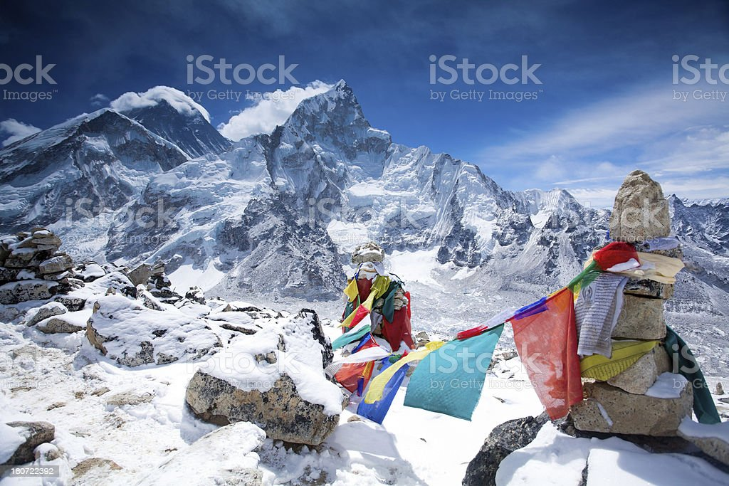Prayer flags flying on the wind in Himalayas stock photo