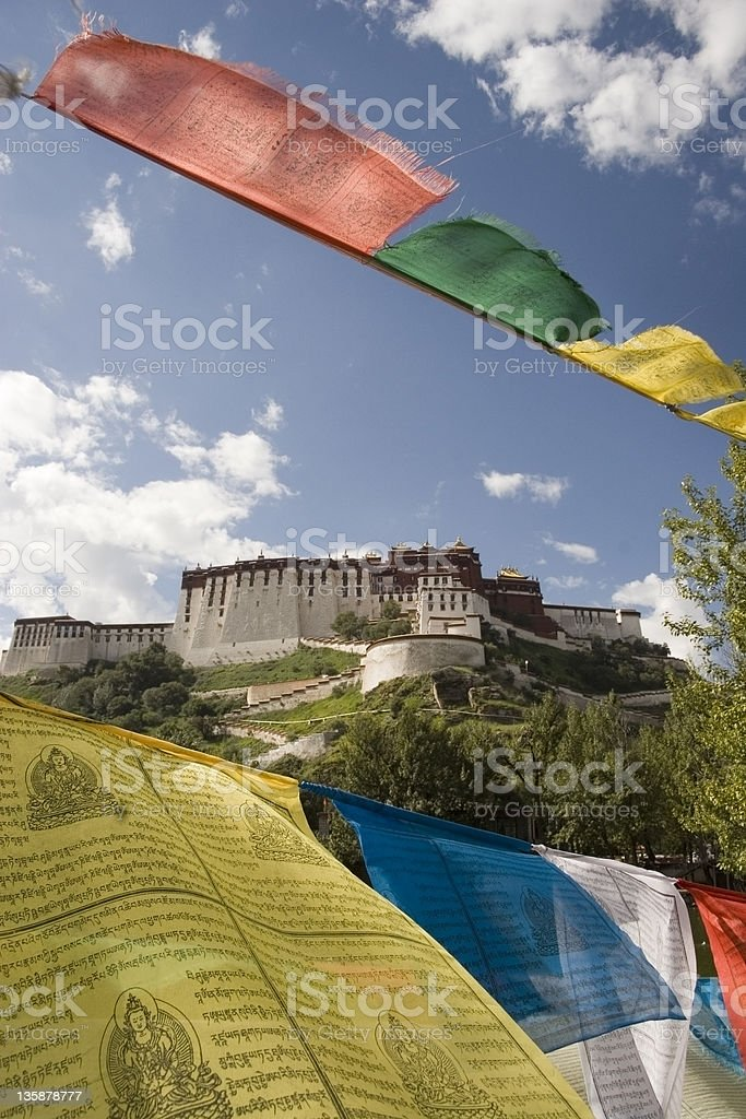Prayer flags framing the Potala Palace in Tibet vertical royalty-free stock photo