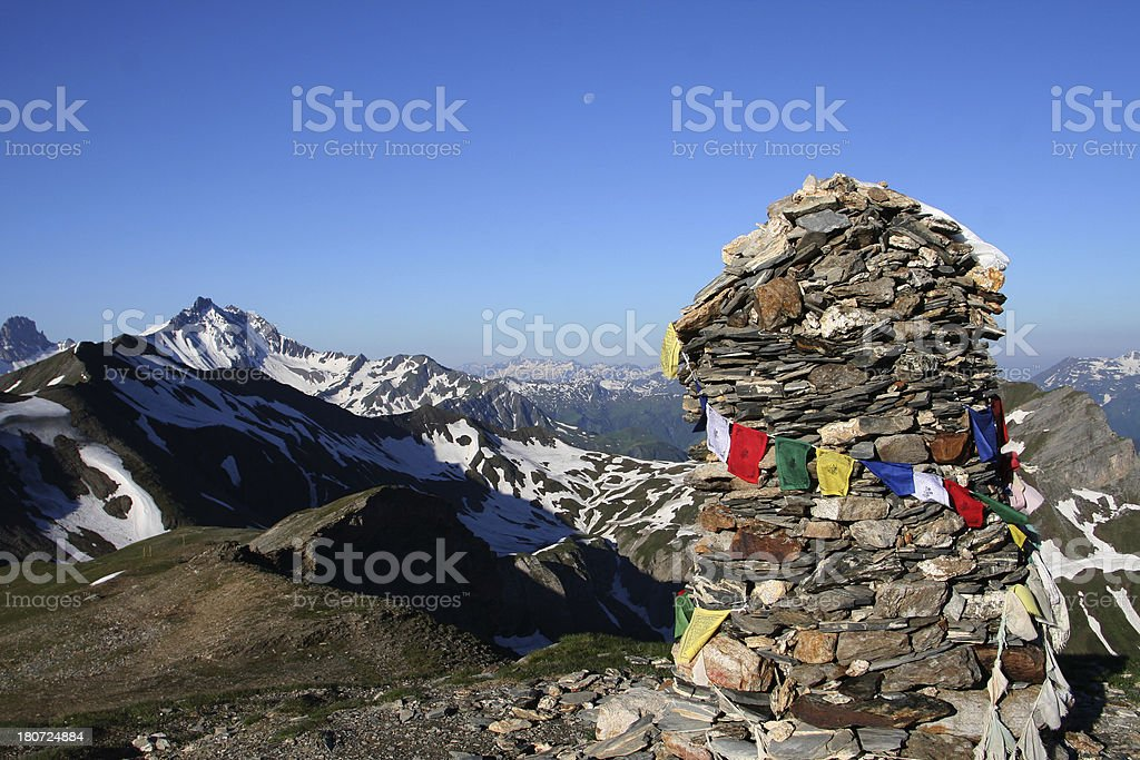 Prayer Flags on Rock Cairn in France royalty-free stock photo