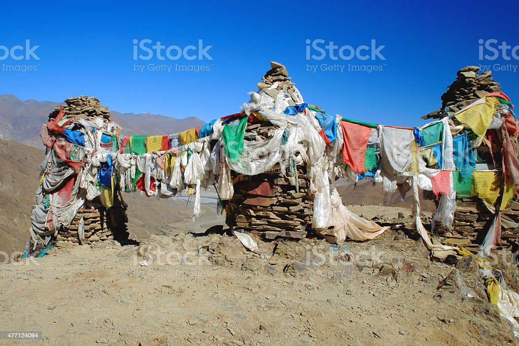 Prayer flags on stone stacks. Kamba La-Tibet. 1529 stock photo