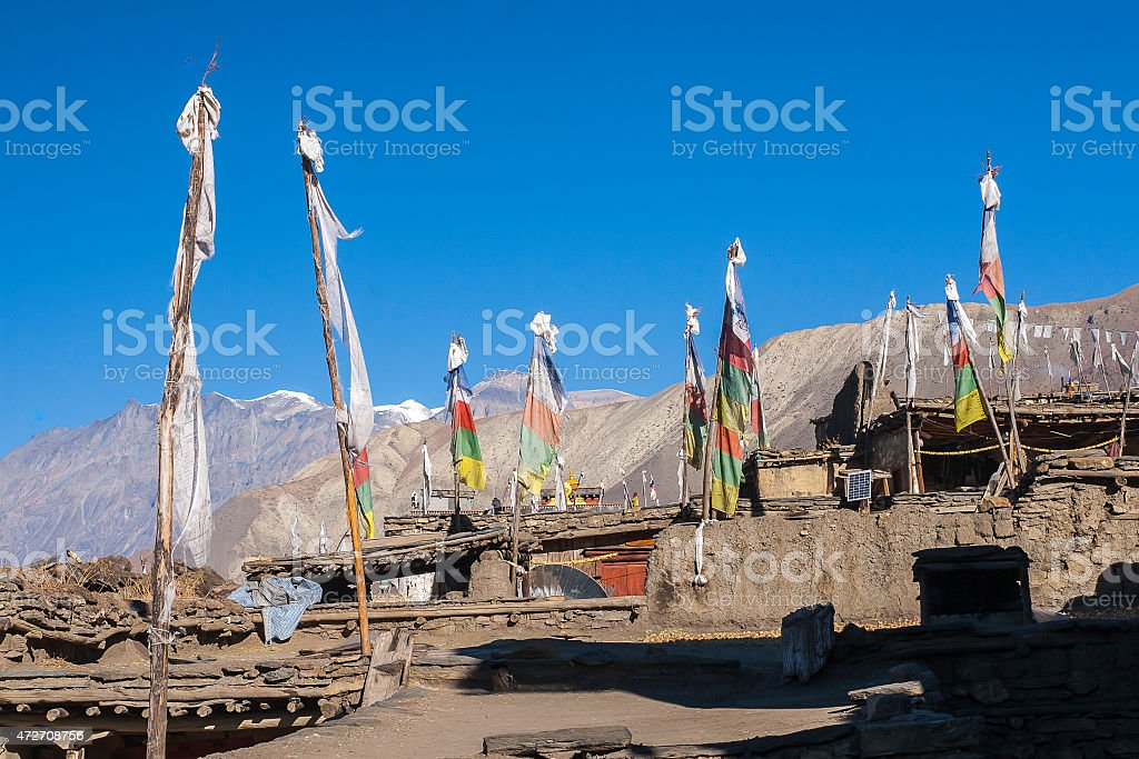 Prayer flags over the houses in the village Jharkot stock photo