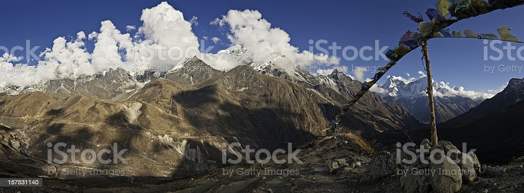Prayer flags panoramic Himalayan vista snow mountain summits panorama Nepal stock photo