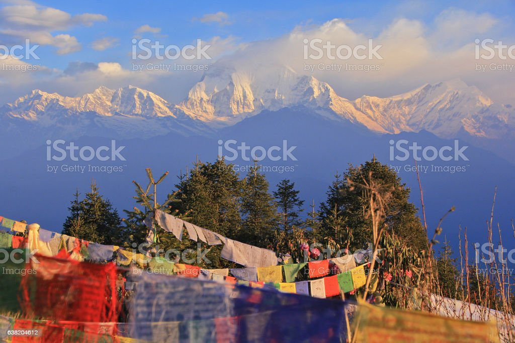 Prayer flags with snowy mountain at poon hill, Nepal stock photo