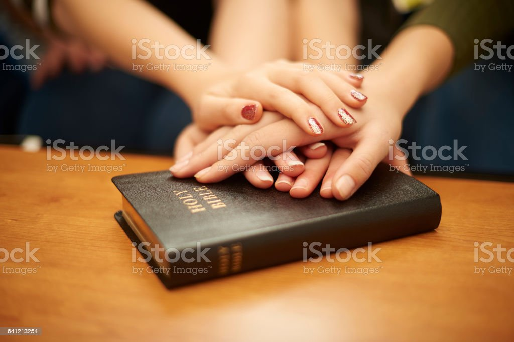 prayer group teen hands stock photo