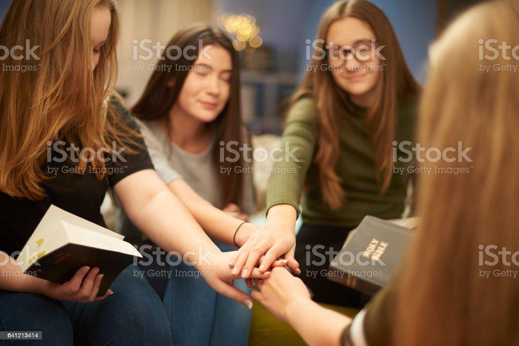 prayer group teens stock photo