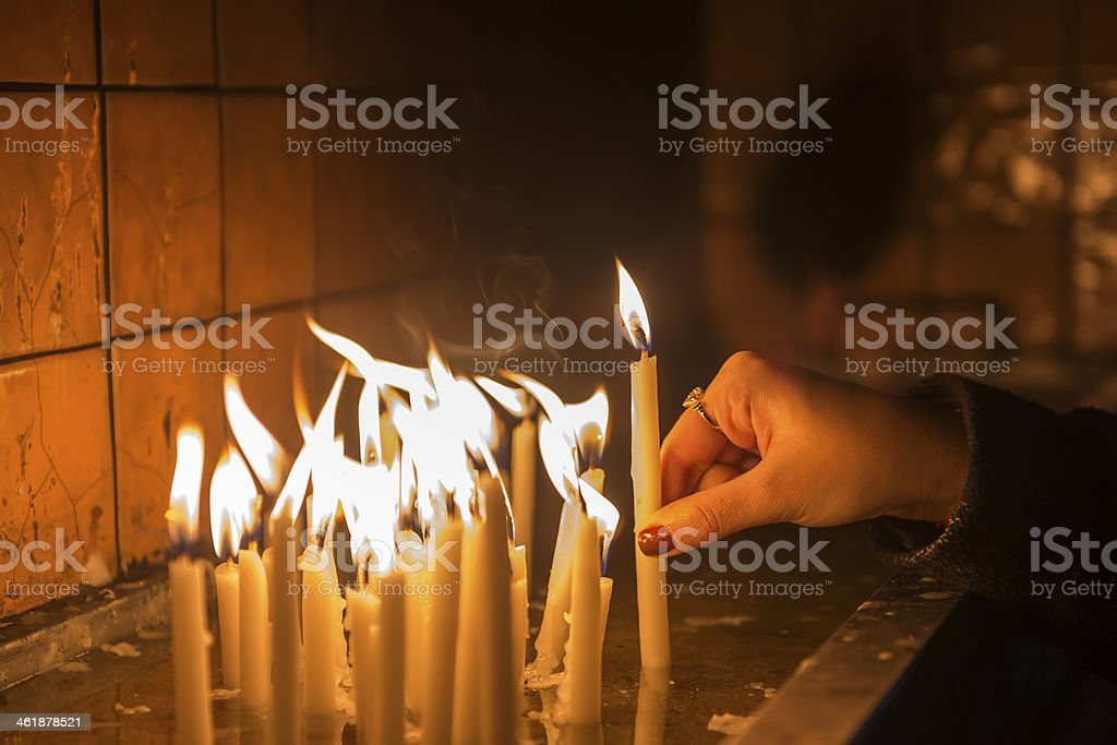 Prayer in church and candles royalty-free stock photo