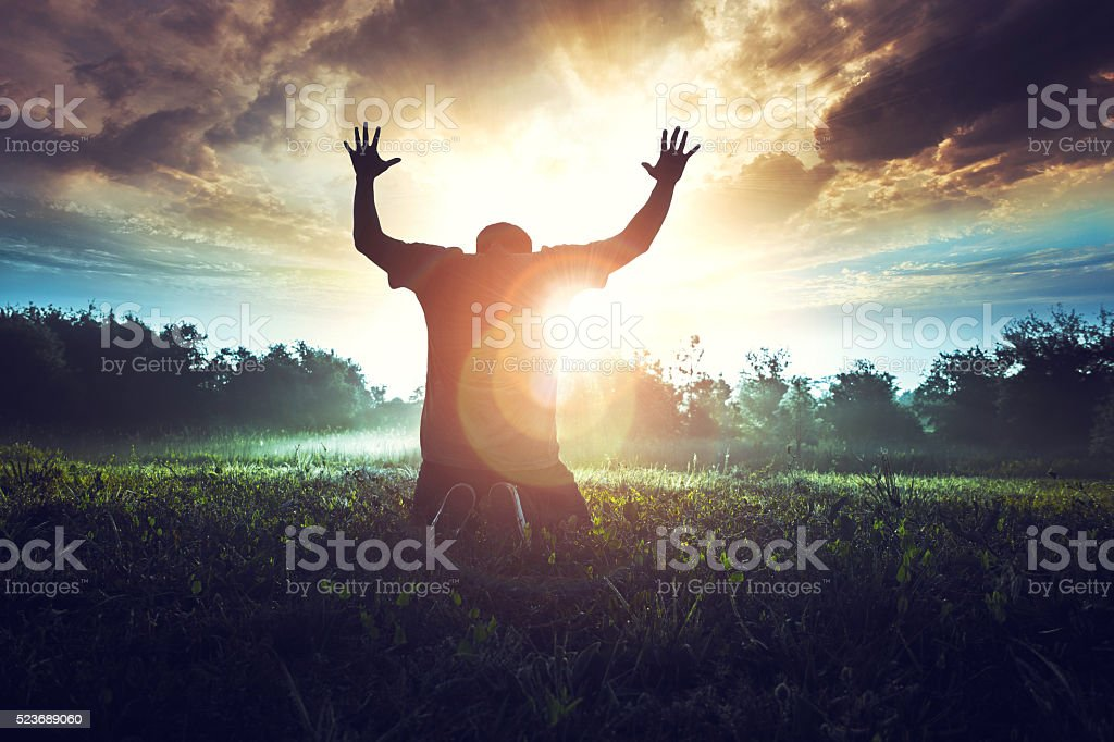 Prayer in the morning in a beautiful sunrise stock photo