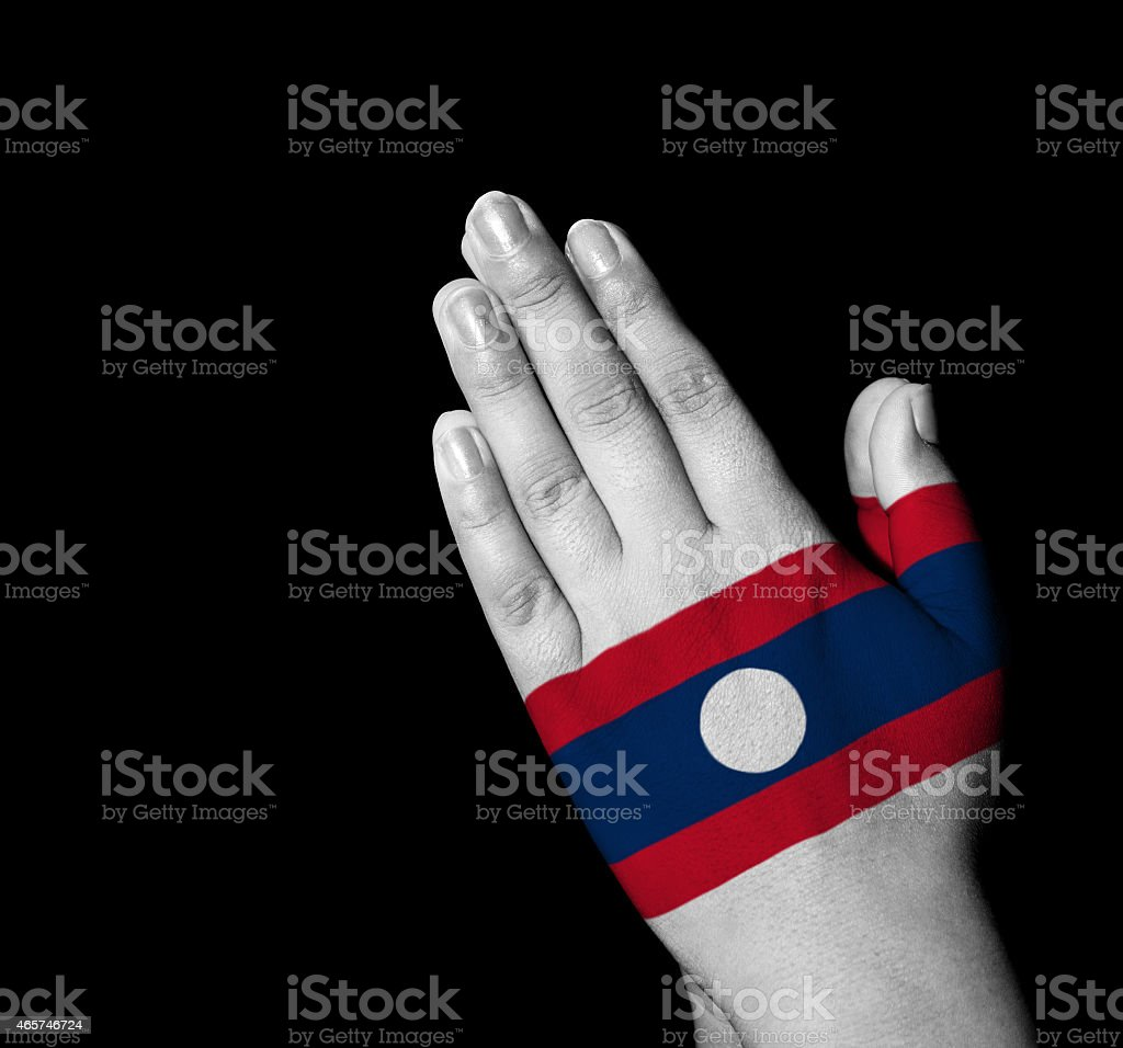 Prayer - Laos flag painted on hands stock photo