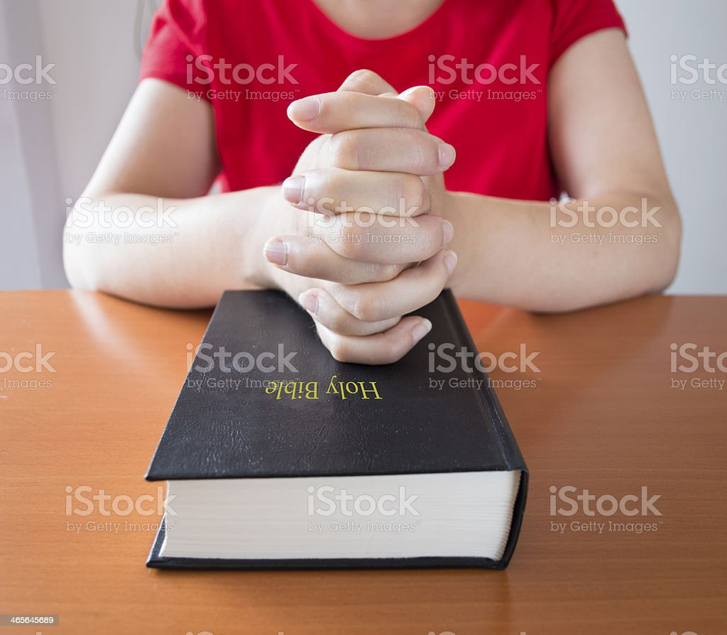 prayer over a holy bible closed royalty-free stock photo