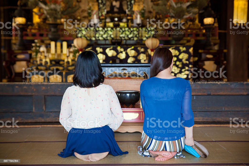 Prayer time - buddhist temple stock photo
