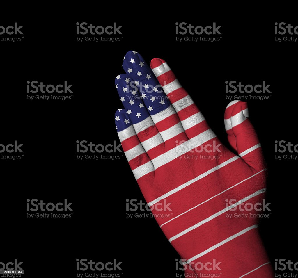 Prayer - USA flag painted on hands stock photo