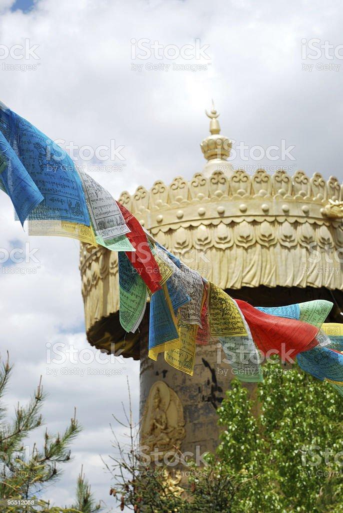 Prayer Wheel and Tibetan Flags stock photo